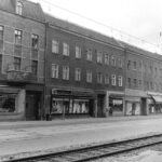 Wilhelminenhofstr, showing the tram tracks and the heavy industrial line alongside the road.