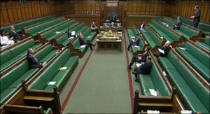 House of Commons during a debate - only a handful of MPs present